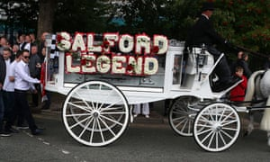 Mourners attend the funeral procession of Paul Massey in Salford, Manchester.
