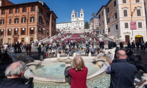 People enjoy the sun day at Rome's Spanish Steps