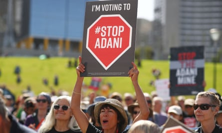 Adani protester with sign