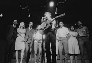 Bob Dylan during a performance at the Newport Folk Festival in 1963. Those visible behind him are (from left) Peter Yarrow, Mary Travers and Paul Stookey (of Peter, Paul and Mary), Joan Baez (partially obscured), Charles Neblett, Rutha Mae Harris and Pete Seeger.