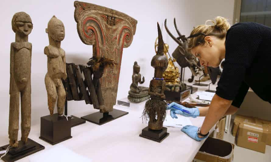 A scientist inventories objects donated to the Museum of Mankind.