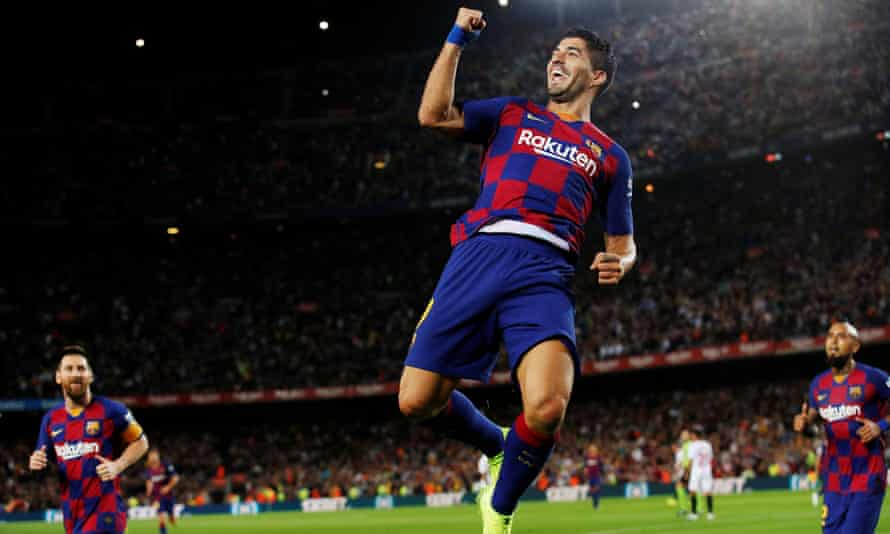 Luis Suárez leaps in celebration after opening the scoring