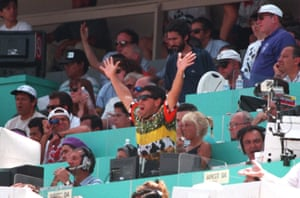 Diego Maradona supports his team from the press seats.