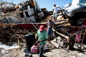 People recover items from a beached boat after Hurricane Dorian in Marsh Harbour on Thursday.