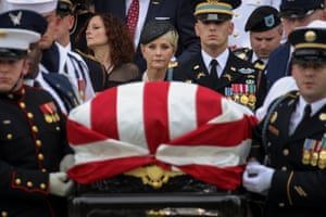 Cindy McCain looks on as military personel carry the casket of the late Senator John McCain.