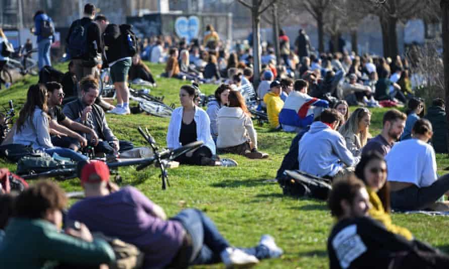 People taking advantage of the winter sunshine in Hackney Wick, east London.