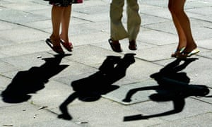 Legs jumping - shadows shown holding papers