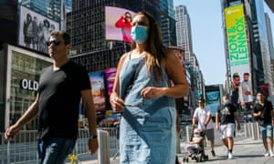 People wear masks around Times Square, as cases of the infectious coronavirus Delta variant continue to rise in New York City.