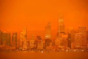 """The San Francisco skyline is obscured in orange smoke and haze as their seen from Treasure Island in San Francisco, California on September 9, 2020. - More than 300,000 acres are burning across the northwestern state including 35 major wildfires, with at least five towns """"substantially destroyed"""" and mass evacuations taking place"""