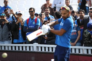 India fans watch Shikhar Dhawan of India warming up during the Group Stage match of the ICC Cricket World Cup 2019 between India and Australia at The Oval.