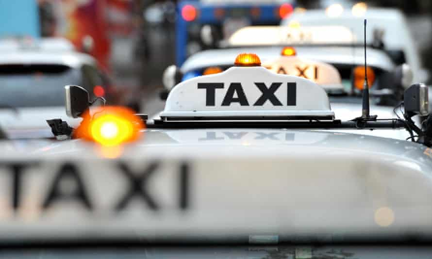 A taxi waits at a rank at Circular Quay in Sydney.