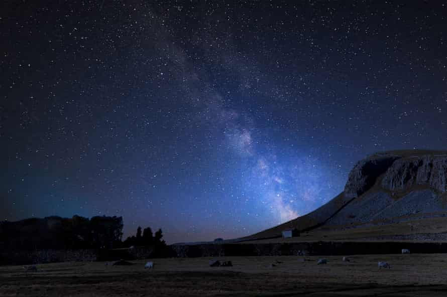 Milky Way composite image, Norber Ridge and stone barn in Yorkshire Dales national park.