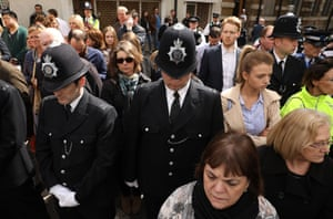Police officers and well-wishers gather in Southwark