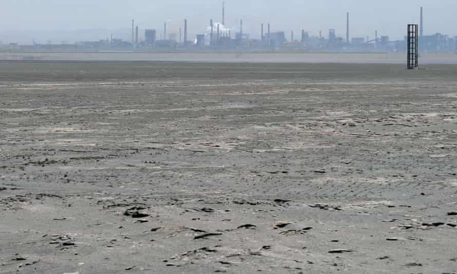 Toxic waste from mining fills the tailings dam in Baotou, Inner Mongolia.