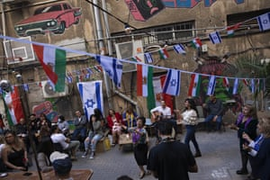 Israelis dance during a party celebrating the Persian new year, known as Nowruz, in a Tel Aviv restaurant's backyard decorated with Israeli and Iranian flags