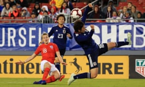 Ellen White of England shoots past Arisa Matsubara of Japan, but also wide of the post.