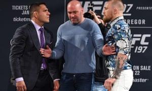 UFC president Dana White stands between Rafael dos Anjos and Conor McGregor