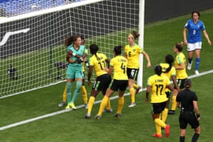 Jamaica's Sydney Scheider is congratulated by her teammates for saving a penalty which is then retaken.