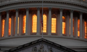 The US flag flies at half-staff in front of the US Capitol in tribute to former President George HW Bush on Sunday.