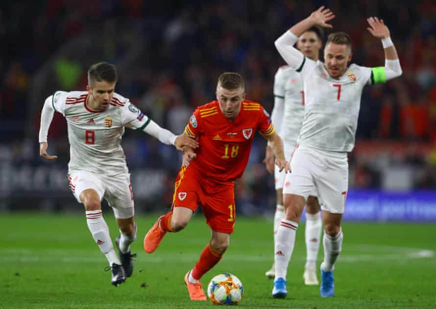 Joe Morrell of Wales (centre) goes past Adam Nagy of Hungary during their Euro 2020 qualifier in November 2019.