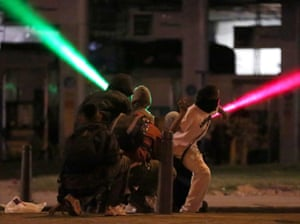 Protesters use laser beams against police in Bogotá