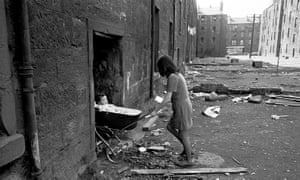 A Mother takes her baby inside her condemned tenement block Gorbals 1970.