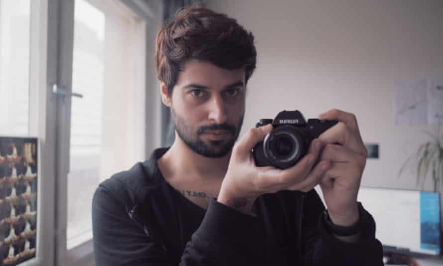 Juan holding up his camera