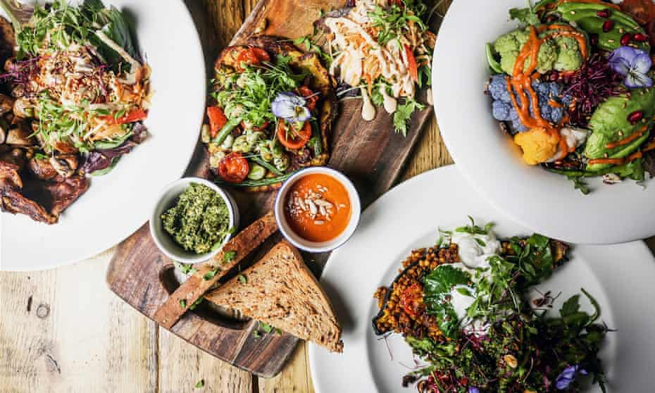 Four plates of food, photographed from above, at Anna-Loka, Cardiff, UK.