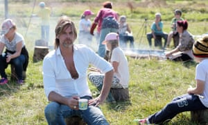 Mike Fairclough headteacher West Rise School, Eastbourne with chlldren from the school, on the marsh near the school