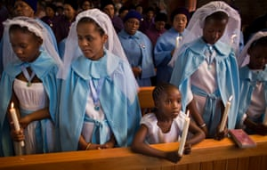 On 8 December 2013, young members of the choir attend a memorial for Nelson Mandela, who died 3 days earlier, at the Regina Mundi church, which became one of the focal points of the anti-apartheid struggle, in Soweto, Johannesburg, South Africa. 8 December.