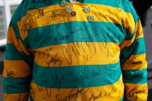 A racegoer sporting a rugby shirt in the famous colours of JP McManus with many autographs including AP and Chantelle McCoy