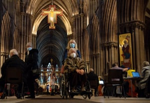 Members of the public at Lichfield Cathedral, Staffordshire, to receive the Oxford/AstraZeneca coronavirus vaccine.