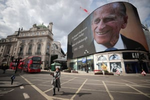 A screen with an image and a message about Britain's Prince Philip, husband of Queen Elizabeth, at Piccadilly Circus after he died at the age of 99.