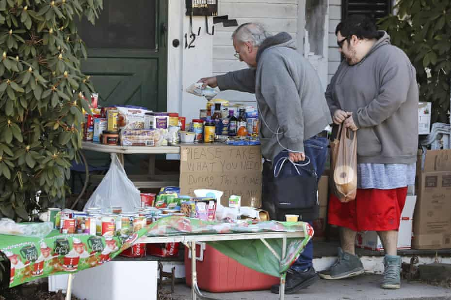 Residents select items on a community table filled with groceries for those in need, in Derry, New Hampshire.