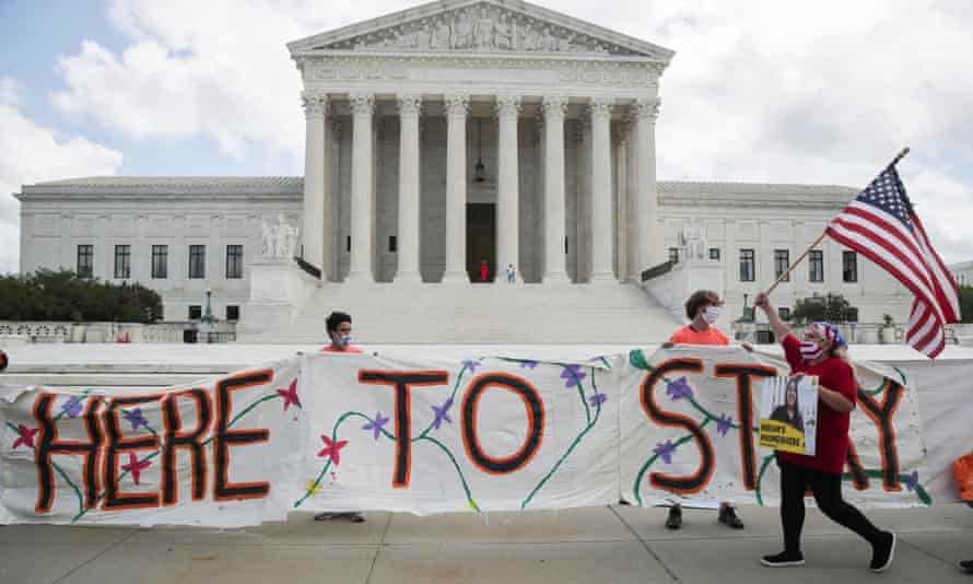 Daca recipients and supporters celebrate outside the US supreme court in Washington DC, on 18 June.