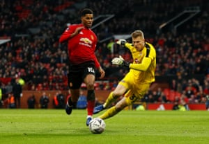 Manchester United's Marcus Rashford goes round Reading's keeper Anssi Jaakkola.