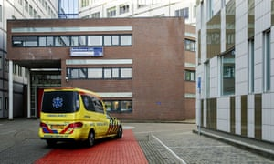 An ambulance pulls into UMC Utrecht, a university hospital in the Netherlands where one of the two Dutch doctors were transferred