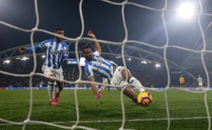 Huddersfield Town's Steve Mounie scores from very close range.