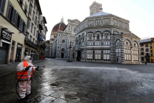 A worker disinfects the popular tourist destination Piazza del Duomo in Florence.