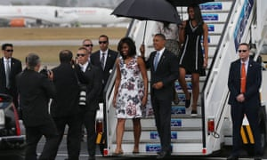 President Barack Obama and his family walk down the stairs as they arrive in Havana, Cuba.