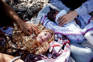 Lesbos, Greece: Twins from Syria arrive with their parents after crossing the Aegean sea from Turkey