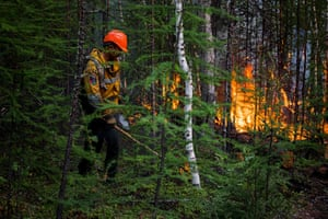 AFPS workers set a backfire to stop a forest fire from spreading