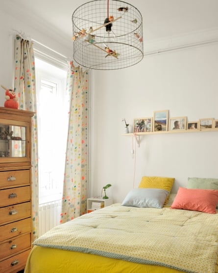 Sweet dreams: sunshine yellows and a homemade lampshade in Chloé and Thomas's bedroom.