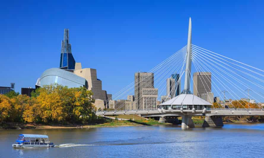 The Canadian Museum for Human Rights (left) and Esplanade Riel Bridge in Winnipeg, Canada.