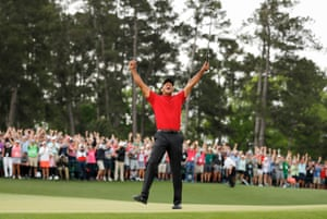 Tiger Woods celebrates after sinking his putt to win the Masters at Augusta on 14 April.