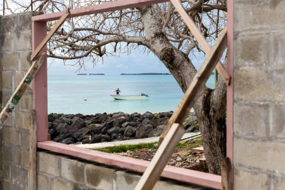 A child plays on a boat in the Funafuti lagoon