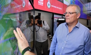 NSW fires: Australian prime minister Scott Morrison is briefed by NSW RFS Commissioner Shane Fitzsimmons on in the NSW Rural Fire Service control room on Sunday after returning from holiday in Hawaii.