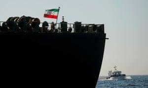 A crew member raises the Iranian flag on the renamed tanker Adrian Darya 1