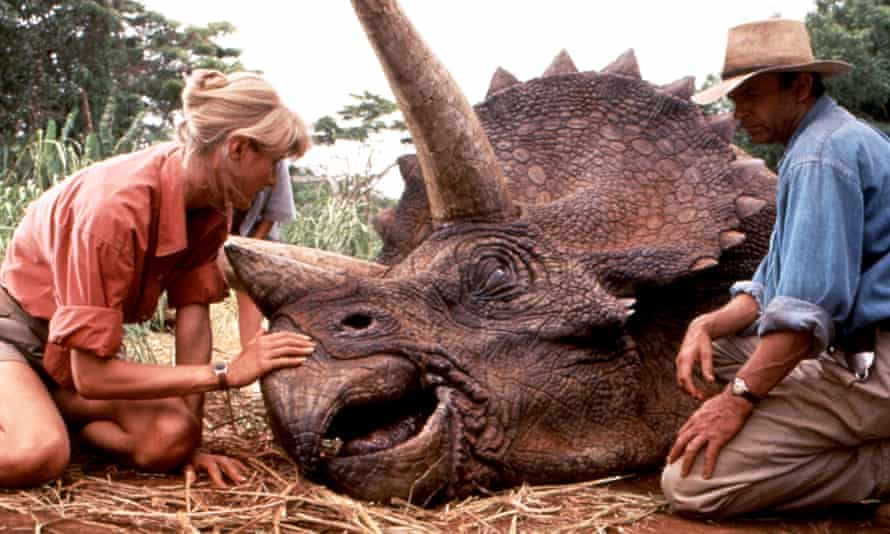 Laura Dern and Sam Neill get tender with a Triceratops in Steven Spielberg's 1993 blockbuster, Jurassic Park. The film has inspired a new golden age of discovery, having 'de-nerded' the study of dinosaurs.