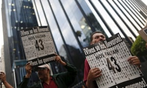Activists protest outside the office of Mexico's attorney general in Mexico City on Monday.